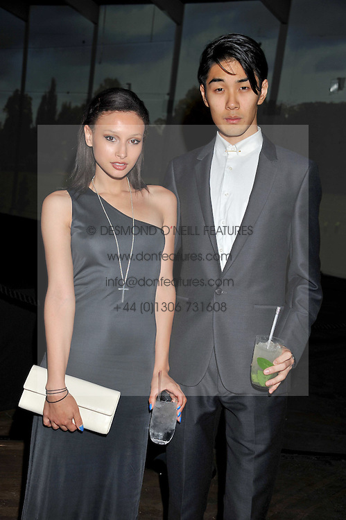 LEAH WELLER and TOMO KURATA at a dinner hosted by Calvin Klein Collection to celebrate the future Home of The Design Museum at The Commonwealth Institute, Kensington, London on 13th October 2011.