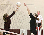 Mount Vernon's Ali Platte (11) tries to tip the ball over the hands of Solon's Jordan Runge (16) during the WaMaC Tournament semifinal game at Mount Vernon High School in Mount Vernon on Thursday October 11, 2012. Solon defeated Mount Vernon 26-24, 25-22.