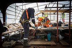 "© Licensed to London News Pictures. 04/05/2016. Birkenhead UK. Picture shows restoration work being carried out on the Daniel Adamson at Camel Laird docks. The Daniel Adamson steam boat has been bought back to operational service after a £5M restoration. The coal fired steam tug is the last surviving steam powered tug built on the Mersey and is believed to be the oldest operational Mersey built ship in the world. The ""Danny"" (originally named the Ralph Brocklebank) was built at Camel Laird ship yard in Birkenhead & launched in 1903. She worked the canal's & carried passengers across the Mersey & during WW1 had a stint working for the Royal Navy in Liverpool. The ""Danny"" was refitted in the 30's in an art deco style. Withdrawn from service in 1984 by 2014 she was due for scrapping until Mersey tug skipper Dan Cross bought her for £1 and the campaign to save her was underway. Photo credit: Andrew McCaren/LNP ** More information available here http://tinyurl.com/jsucxaq **"