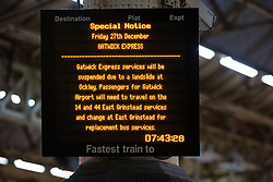 © Licensed to London News Pictures. 27/12/2013. London, UK. A warning sign explaining that the Gatwick Express service is suspended as a result of adverse weather conditions at Victoria Railway station in London. Many National Rail services have been cancelled and disrupted as a result of very strong winds and rain. Southeastern Railways have cancelled all trains as a precaution until midday today and no rail services are running to Gatwick Airport this morning. Photo credit : Vickie Flores/LNP