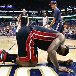 Mar 22, 2014; New Orleans, LA, USA; Miami Heat forward LeBron James (6) reacts after falling under the goal during the third quarter of a game at the Smoothie King Center. The Pelicans defeated the Heat 105-95. Mandatory Credit: Derick E. Hingle-USA TODAY Sports