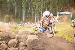 Nino Schurter tries hard to make up time after having flatted in the fifth lap of the 2014 UCI Mountainbike World Cup Pietermaritzburg.