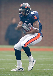 Virginia Cavaliers RB Raynard Horne (44) carries the ball during the UVA Spring game.  The University of Virginia Football Team played their Spring game at Scott Stadium in Charlottesville, VA on April 14, 2007.