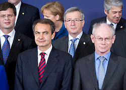 Jean-Claude Juncker, Luxembourg's prime minister, center, poses  for the family photo with his colleagues, during the European Summit, in Brussels, on Thursday, March 25, 2010. Jan Peter Balkenende, the Netherlands's prime minister, far left, Jose Zapatero, Spain's prime minister,  front left, Herman Van Rompuy, president of the European Council, front right, and Jose Socrates, Portugal's prime minister, back right. (Photo © Jock Fistick)