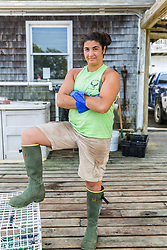 "Ashley Conrad, crew on the ""Hunter James"" on the wharf at Potts Harbor Lobster in Harpswell, Maine."