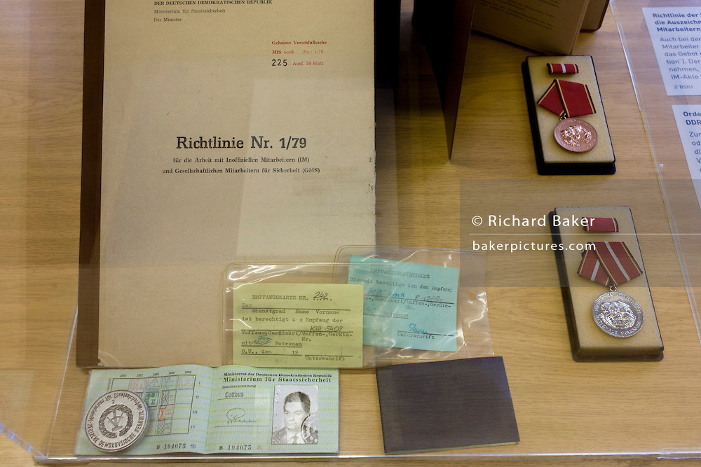 ID papers for an anonymous secret agent from Cottbus, Germany, an exhibit in the ministerial headquarters of the Stasi secret police in Communist East Germany, the GDR. Built in 1960, the complex now known as the Stasi Museum. Between 1950 and 1989, the Stasi employed a total of 274,000 people in an effort to root out the class enemy. Before the fall of the Wall, it was a 22-hectare complex of espionage whose centrepiece is the office and working quarters of the former Minister of State Security, Erich Mielke who considered their role as the 'shield and sword of the party', conducting one of the world's most efficient spying operations against its political dissenters during its 40-year old socialist history. The Stasi Museum is a 22-hectare complex of research  and memorial centre concerning the political system of the former East Germany. During Hitler's Third Reich, the Gestapo had one agent for every 2,000 citizens whereas the Stasi had approximately an spy for every 6.5. Here at the Stasi HQ alone 15,000 were employed plus the many regional stations. German media called East Germany 'the most perfected surveillance state of all time' - administered from this complex of offices.