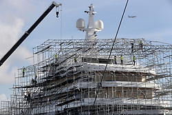 Construction workers dismantle scaffolding that encompasses a yacht under construction at Harbor Towne Marina in Dania Beach ahead of Hurricane Irma. (Photo by Mike Stocker /Sun Sentinel/TNS/Sipa USA)<br />SOUTH FLORIDA OUT; NO MAGS; NO SALES; NO INTERNET; NO TV