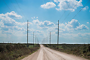 Power transmission lines along a dirt road in western OKlahoma