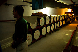 Major Sabih-ur-Rehman, special assistant to the CEO, tours the whiskey cellars, Rawalpindi, Pakistan, Sept. 12, 2007. The almost 150 year old company is preparing to bring the Muslim world's first 20 year old single malt whisky to the market. However, they can only sell to non-Muslims, who comprise 3 percent of Pakistan's population.