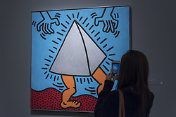 October 1, 2018 - London, UK - LONDON, UK. A visitor photographs ''Untitled'', 1985, by Keith Haring (Est. GBP700,000 - 900,000). Preview of artworks in Sotheby's Frieze sales at Sotheby's New Bond Street.  The auction will take place 5 October during Frieze and Frieze Masters – the world's most vibrant Contemporary and Modern art fairs. (Credit Image: © Stephen Chung/London News Pictures via ZUMA Wire)