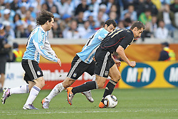 03.07.2010, CAPE TOWN, SOUTH AFRICA, Miroslav Klose of Germany attempts to get past Javier Mascherano of Argentina as Lionel Messi of Argentina looks on during the Quarter Final, Match 59 of the 2010 FIFA World Cup, Argentina vs Germany held at the Cape Town Stadium. EXPA Pictures © 2010, PhotoCredit: EXPA/ nph/  Kokenge