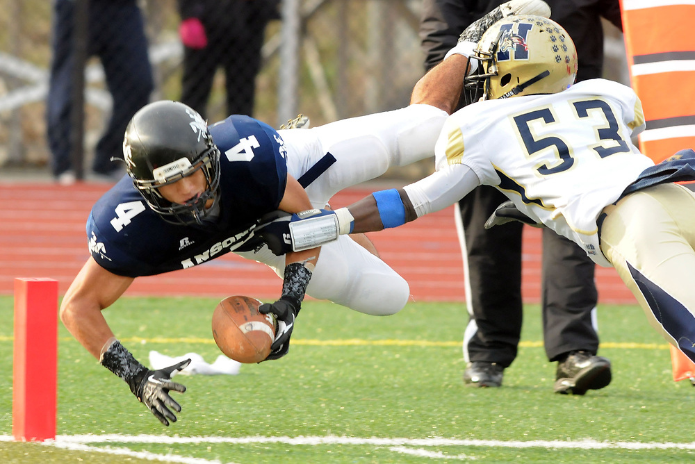 Middletown: Class LL football semifinals between Ansonia and Hyde. Ansonia's Andrew Matos tackled by Hyde's Kahlil Morant one play before the team's last touchdown. Mara Lavitt/New Haven Register<br /> <br /> 12/02/12
