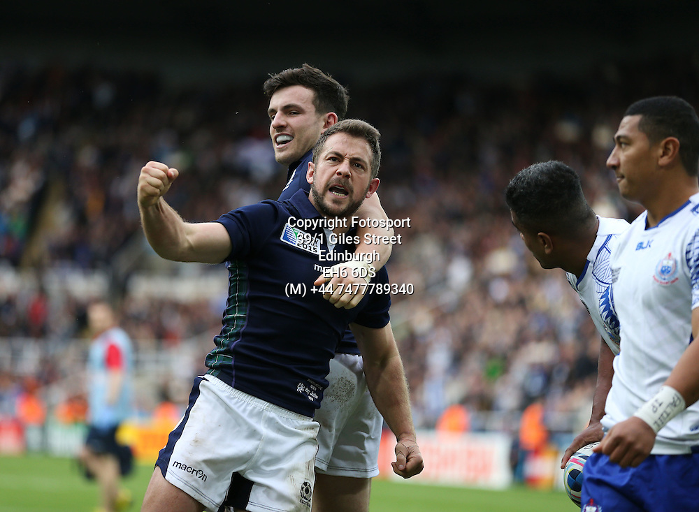 Greig Laidlaw - Scotland captain is ecstatic as he celebrates his match winning try with Matt Scott (R) late in the game to take Scotland into the quarter finals of the Rugby World Cup.<br />