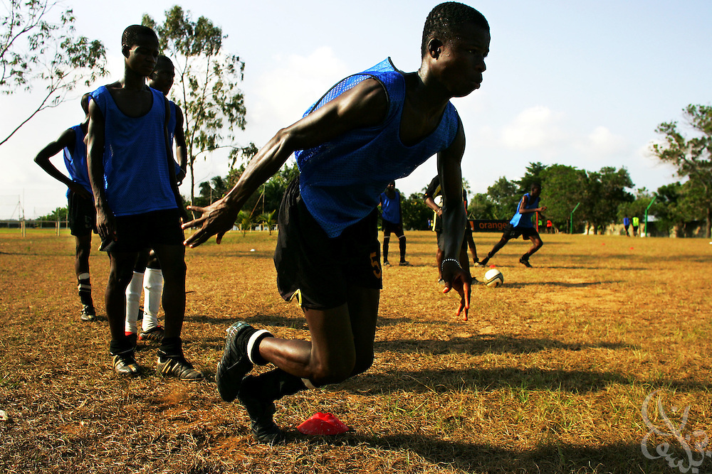 Teenage Ivorian football players take part in drills during an intensive morning training session at the ASEC football academy February 16, 2006 in Abidjan, Côte d'Ivoire. ASEC academy has an established history of producing top notch footballers who go on to play in the top European football leagues.
