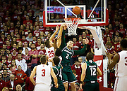 UW-Green Bay guard Turner Botz (2) goes up for a rebound during the first half of the UW-Green Bay Men's Basketball game versus University of Wisconsin at the Kohl Center, Wednesday, December 14, 2016.