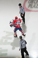 KELOWNA, CANADA - JANUARY 16: Tyrell Goulbourne #12 of the Kelowna Rockets drops the gloves with Carter Proft #15 of the Spokane Chiefs at the Kelowna Rockets on January 16, 2013 at Prospera Place in Kelowna, British Columbia, Canada (Photo by Marissa Baecker/Shoot the Breeze) *** Local Caption ***