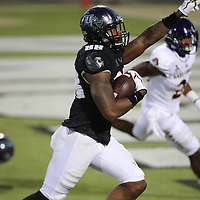 ORLANDO, FL - OCTOBER 14: Jordan Akins #88 of the UCF Knights celebrates a touchdown as he crosses the goal line during a NCAA football game between the East Carolina Pirates and the UCF Knights at Spectrum Stadium on October 14, 2017 in Orlando, Florida. (Photo by Alex Menendez/Getty Images)