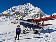 An exciting landing on Eldridge Glacier culminates a flightseeing tour in a small airplane over Denali National Park and Preserve, Alaska, USA. See a vast wilderness of glaciers, icy peaks, and mile deep granite gorges in the Alaska Range. For licensing options, please inquire.