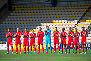 The Aberdeen players give a minutes applause in memory of Fernando Ricksen, the former Rangers player who passed away on 18/09/2019 after suffering from Motor Neurone Disease, before the Ladbrokes Scottish Premiership match between Livingston FC and Aberdeen FC at The Tony Macaroni Arena, Livingston, Scotland on 21 September 2019.
