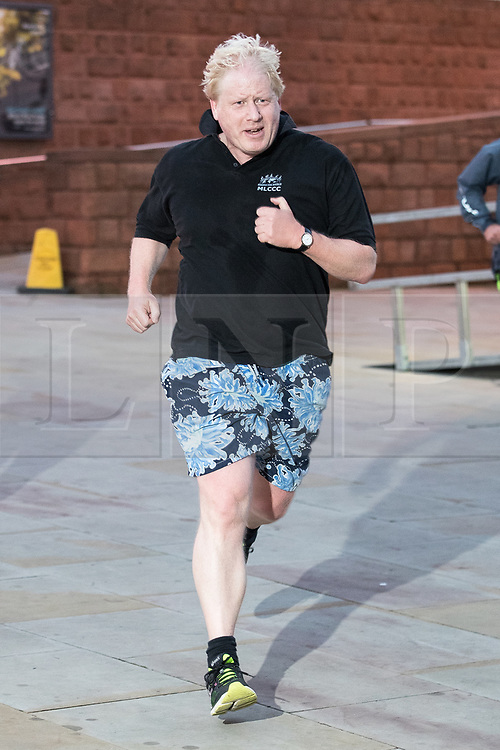 © Licensed to London News Pictures. FILE PICTURE: 03/10/2017. Manchester, UK. British foreign secretary BORIS JOHNSON seen running ahead of his speech on day three of the Conservative Party Conference. The PM was pictured today wearing the same shorts as he returned to jogging for the first time since contracting COVID-19. Photo credit: Joel Goodman/LNP