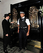 12.APRIL.2011. LONDON<br /> <br /> DRAMA QUEEN TARA PALMER TOMKINSON LEAVES SCOTTS RESTAURANT IN MAYFAIR WITH THE AID OF A POLICE ESCORT. THE SOCIALITE ATTEMPTED TO LEAVE EARLIER WITHOUT THE AID OF ANY POLICE, BUT OVER EXCITED RESTAURANT STAFF AND PHOTOGRAPHERS GOT INTO A SCUFFLE RESULTING IN TARA'S WAITING CAB DRIVING AWAY WITHOUT HER!<br /> <br /> BYLINE: EDBIMAGEARCHIVE.COM<br /> <br /> *THIS IMAGE IS STRICTLY FOR UK NEWSPAPERS AND MAGAZINES ONLY*<br /> *FOR WORLD WIDE SALES AND WEB USE PLEASE CONTACT EDBIMAGEARCHIVE - 0208 954 5968*
