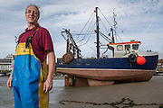 Colin Sharp<br /> <br /> Boy Callum - WO4<br /> <br /> 5th Generation Fisherman<br /> <br /> Main Activity: Trawling<br /> Folkestone was founded on its fishing industry which dates back to pre-Roman times.  During its heyday there were over 100 boats operating out of the busy harbour and employing over 1000 people in the town.  However today, there are only 8 working boats left, employing just over 20 people. The boats are owned and managed by Folkestone families who have a strong fishing heritage. Photographer Andrew Aitchison, has been working with Folkestone Trawlers to capture portraits of the active fishermen in the summer of 2016.