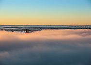 Dawn over San Francisco Bay with Golden Gate Bridge, Bay Bridge, and SF skyline above the fog.  Limited edition of 25.  22x16 inches on archival matte paper.