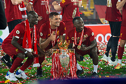 LIVERPOOL, ENGLAND - Wednesday, July 22, 2020: Liverpool's Sadio Mané, Dejan Lovren and Naby Keita celebrate with the Premier League trophy as the Reds are crowned Champions after the FA Premier League match between Liverpool FC and Chelsea FC at Anfield. The game was played behind closed doors due to the UK government's social distancing laws during the Coronavirus COVID-19 Pandemic. Liverpool won 5-3. (Pic by David Rawcliffe/Propaganda)