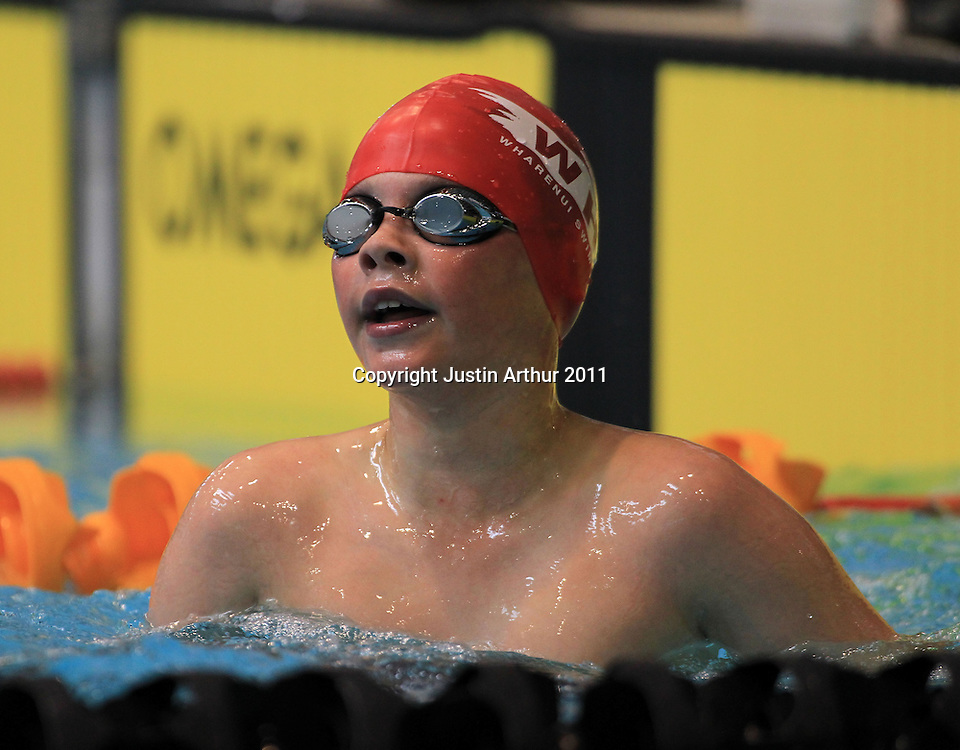 Thomas Wilson looks on after his race in the boys 10 & under 200 freestyle during the 2011  New Zealand Junior Swimming Championships, Day 1, Wellington Aquatics Centre, Kilbirnie, Wellington on Saturday, 19 February 2011. Photo: Justin Arthur/photosport.co.nz