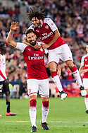 July 15 2017: Arsenal player Olivier Giroud (12) celebrates his goal with Arsenal player Mohamed Elneny (35) at the International soccer match between English Premier League giants Arsenal and A-League team Western Sydney Wanderers at ANZ Stadium in Sydney.