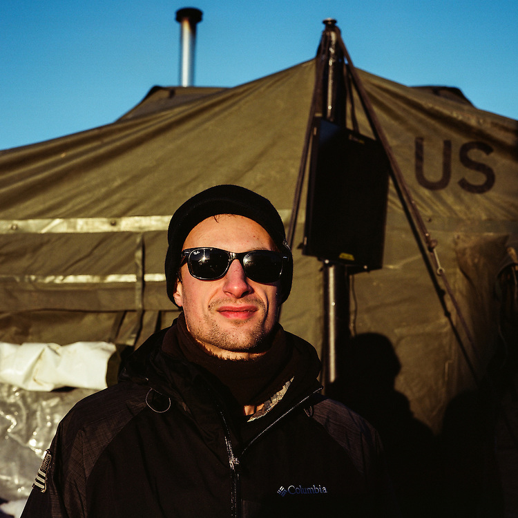 OCETI SAKOWIN CAMP, CANNON BALL, NORTH DAKOTA - DECEMBER 5, 2016: Veteran Beau Ryan Best outside of the vet tent at the Oceti Sakowin Camp at Standing Rock. Best was one of thousands of veterans that came to Standing Rock to protest the construction of the Dakota Access Pipeline.
