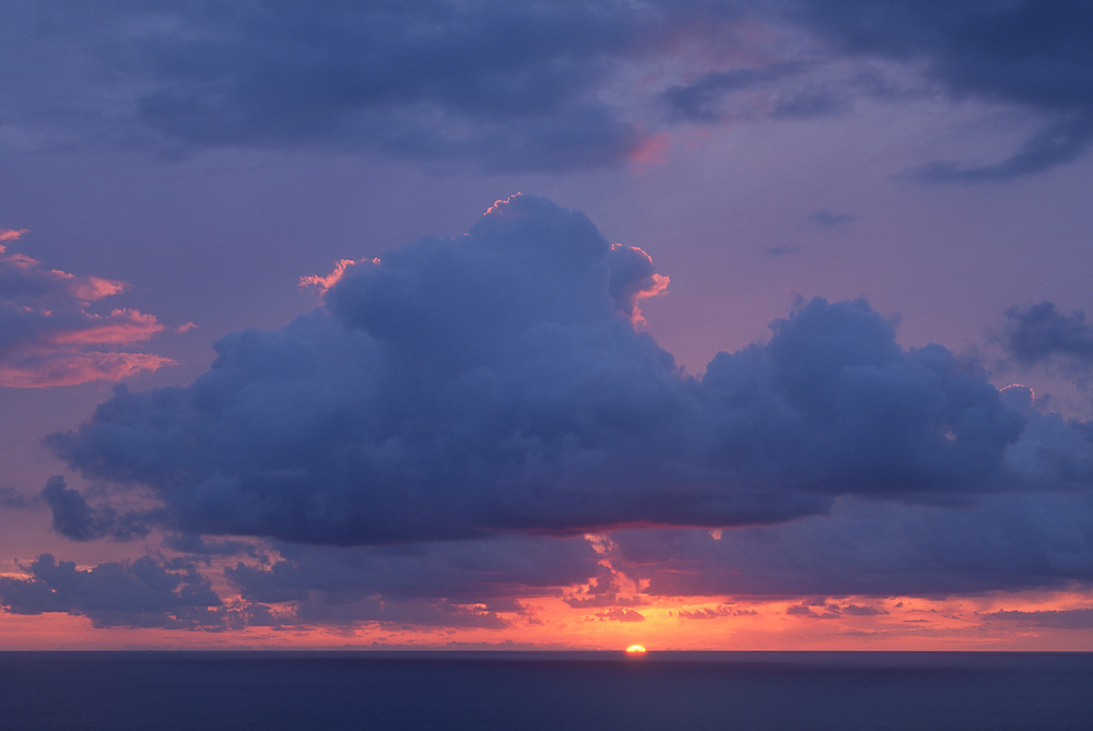 Sun setting in to Pacific Ocean on the Kohala Coast of the Big Island of Hawaii.