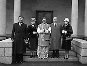 His Grace Most Reverend Dr. Charles Mc Quaid, Archbishop of Dublin and Primate of Ireland, ordained four new priests all for  English Dioceses, at Holy Cross College Clonliffe..Pictured shows Fr. P. Reilly (Dublin), and family.12.03.1960.