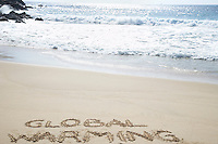 Global warming text written in beach elevated view