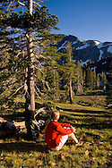 Women backpackers camping and enjoying the view, Desolation Wilderness, El Dorado National Forest, California