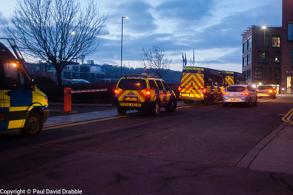 South Yorkshire Police Officers set off in convoy from Main Street Police station in Rotherham to execute Warrants in Eastwood Rotherham early on Tuesday Morning<br /> <br /> 04 March 2014<br /> Image &copy; Paul David Drabble <br /> <br /> www.pauldaviddrabble.co.uk