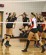 Solon's Emma Rickels (9) is pumped up after a score as Maquoketa's Allison Vandemore (5) walks back to huddle with her team during the WaMaC Tournament Championship game at Mount Vernon High School in Mount Vernon on Thursday October 11, 2012. Solon defeated Maquoketa 17-25, 25-15, 15-10.