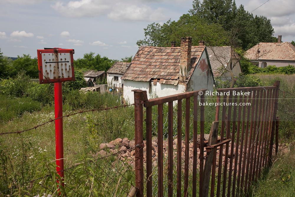 Land belonging to poor, rural housing near the town of Bakonyszentlaszlo, Gyor-Moson-Sopron, Hungary