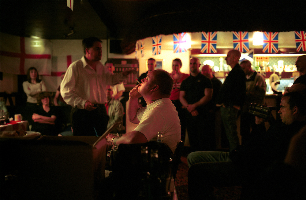 BNP (British National Party) supporters fill a pub in Princes End, near Dudley in the West Midlands, to hear their local candidate John Salvage and BNP Chairman Nick Griffin speak, urging supporters to get out and vote in the Local Council Elections of May 2nd. Photo shows Nick Griffin talking to a supporters.