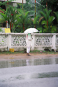 Man in the rain India, Kerala, a state on the tropical coast of south west India
