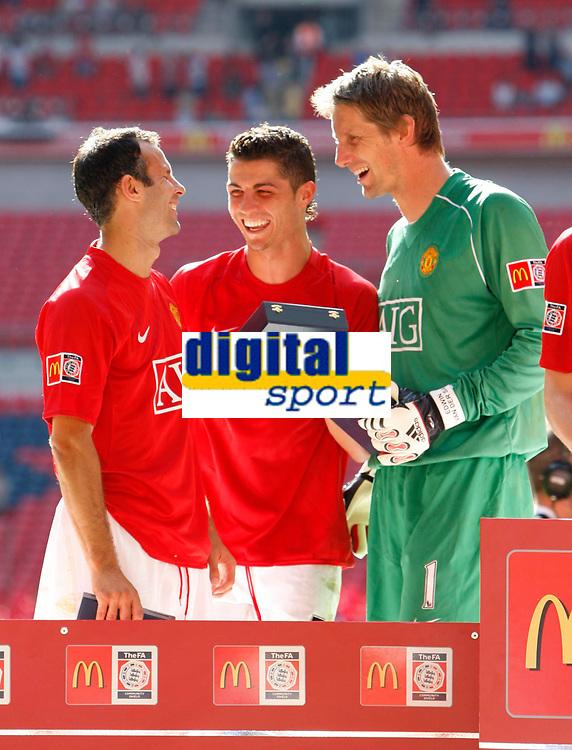 Photo: Richard Lane/Sportsbeat Images.<br />Manchester United v Chelsea. FA Community Shield. 05/08/2007. <br />(lt to rt) United's Ryan Giggs, Christiano Ronaldo and Edwin Van Der Sar celebrate.