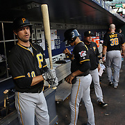 NEW YORK, NEW YORK - June 15: Jordy Mercer #10 of the Pittsburgh Pirates in the dugout preparing to bat during the Pittsburgh Pirates Vs New York Mets regular season MLB game at Citi Field on June 15, 2016 in New York City. (Photo by Tim Clayton/Corbis via Getty Images)