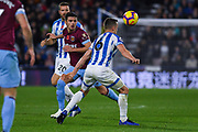 Aaron Cresswell of West Ham United (3) flicks the ball over Jonathan Hogg of Huddersfield Town (6) during the Premier League match between Huddersfield Town and West Ham United at the John Smiths Stadium, Huddersfield, England on 10 November 2018.