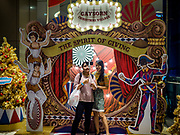 "23 NOVEMBER 2018 - BANGKOK, THAILAND:  Women take a ""selfie"" in front of a Christmas display in Gaysorn, an exclusive mall in Bangkok. Although Thailand is an overwhelmingly Buddhist country, the commercial aspects of Christmas are widely observed, especially in Thailand's urban areas, which have large concentrations of Europeans and Americans.    PHOTO BY JACK KURTZ"