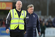 AFC Wimbledon manager Wally Downes walking off the pitch during the EFL Sky Bet League 1 match between AFC Wimbledon and Rochdale at the Cherry Red Records Stadium, Kingston, England on 8 December 2018.