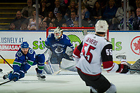 KELOWNA, BC - SEPTEMBER 29:  Christopher Tanev #8 tries to block a shot on Jacob Markstrom #25 of the Vancouver Canucks by the Arizona Coyotes at Prospera Place on September 29, 2018 in Kelowna, Canada. (Photo by Marissa Baecker/NHLI via Getty Images)  *** Local Caption *** Christopher Tanev;Jacob Markstrom