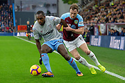 West Ham United midfielder Michail Antonio (30) holds back Burnley defender Charlie Taylor (3) during the Premier League match between Burnley and West Ham United at Turf Moor, Burnley, England on 30 December 2018.
