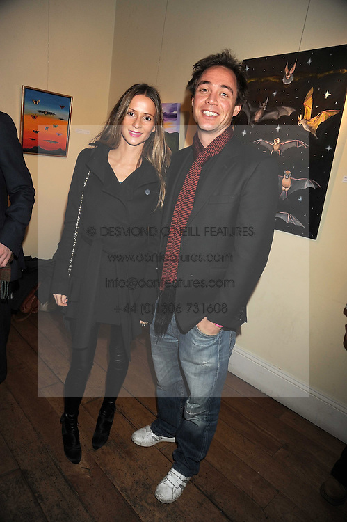 AMANDA CROSSLEY and DAN PHILIPSON at an exhibition of Sarah-Jane Boler's paintings entitled 'Life on The Farm' held at The Troubadour, 265 Old Brompton Road, London on 27th November 2008.