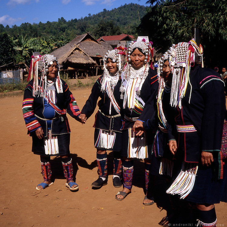 Akha women dressed in traditional clothes, dancing a traditional dance during a festival at Huei Naam Kun village that is located in the mountains near Chiang Rai.