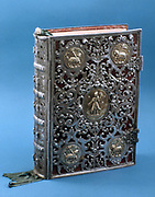Missal with silver cover with roundels showing the Lamb of God. Liturgical book with text for celebration of Mass through the year. 17th century.